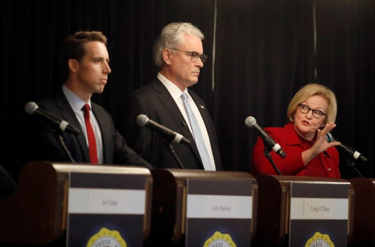 Incumbent Democratic Sen. Claire McCaskill, right, speaks alongside Independent candidate Craig O'Dear, center, and Republican U.S. Senate candidate Josh Hawley, left, during a candidate forum at the annual Missouri Press Association convention Friday, Sept. 14, 2018, in Maryland Heights, Mo.