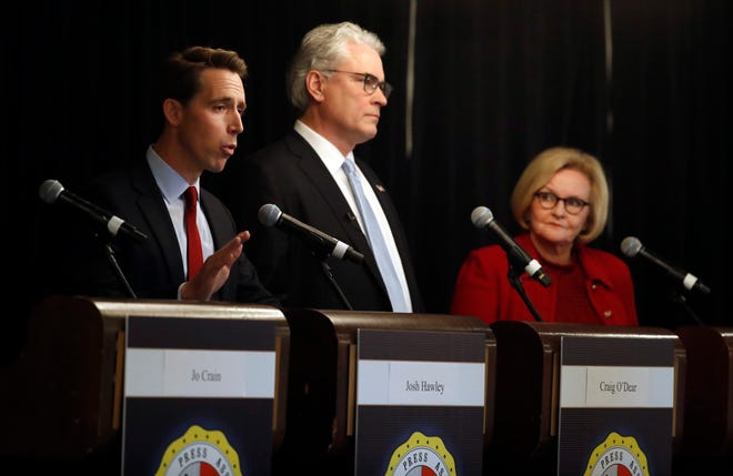 Republican U.S. Senate candidate Josh Hawley, left, speaks alongside Independent candidate Craig O'Dear, center, and incumbent Democratic Sen. Claire McCaskill during a candidate forum at the annual Missouri Press Association convention Friday, Sept. 14, 2018, in Maryland Heights, Mo. (AP