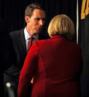 Republican U.S. Senate candidate Josh Hawley, left, talks with incumbent Democratic Sen. Claire McCaskill of Missouri at the end of a candidate forum at the annual Missouri Press Association convention Friday, Sept. 14, 2018, in Maryland Heights, Mo.