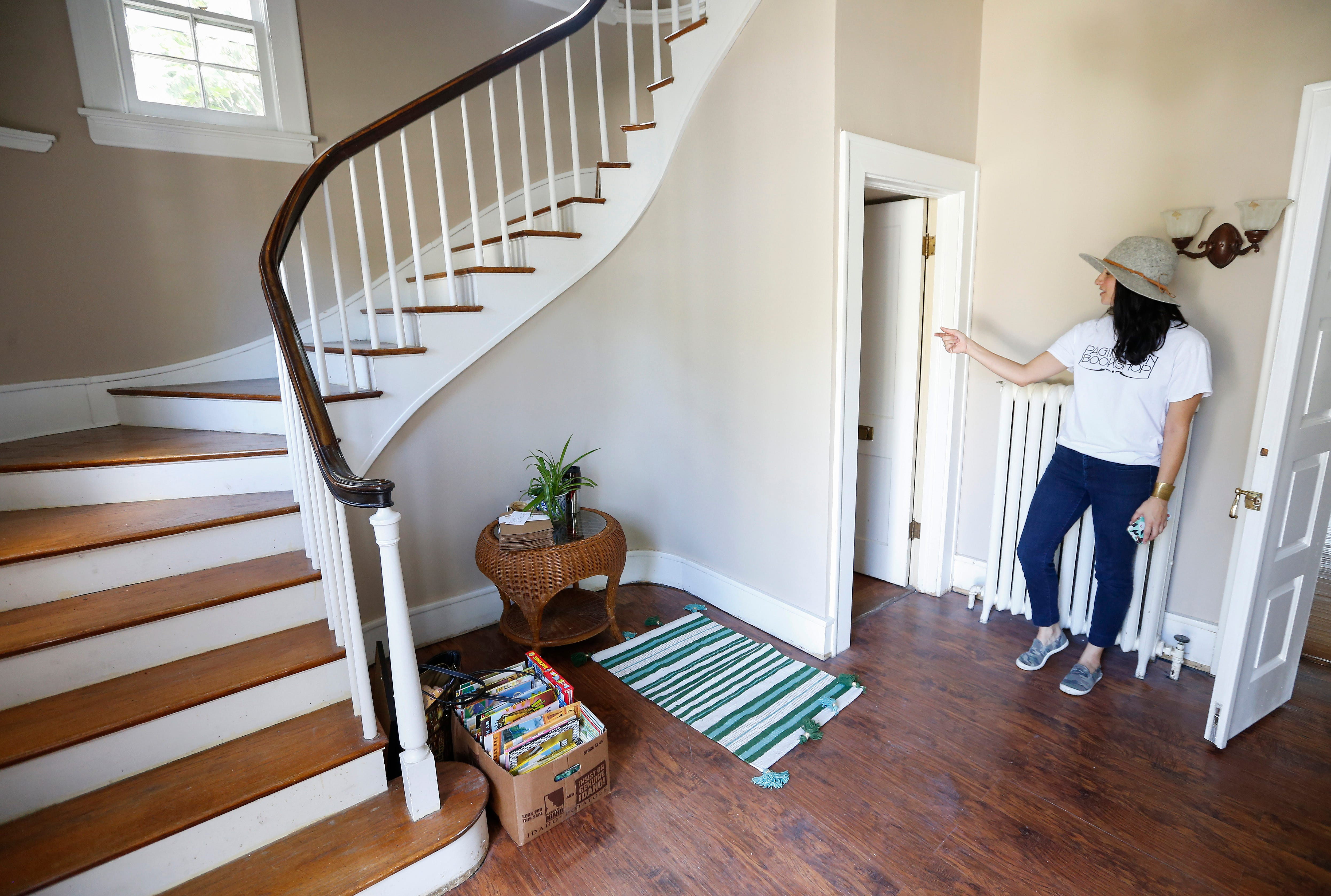 Jennifer Murvin, one of the owners of Pagination Bookshop points out their Harry Potter style room under the stairs at their location at 1150 E. Walnut St.