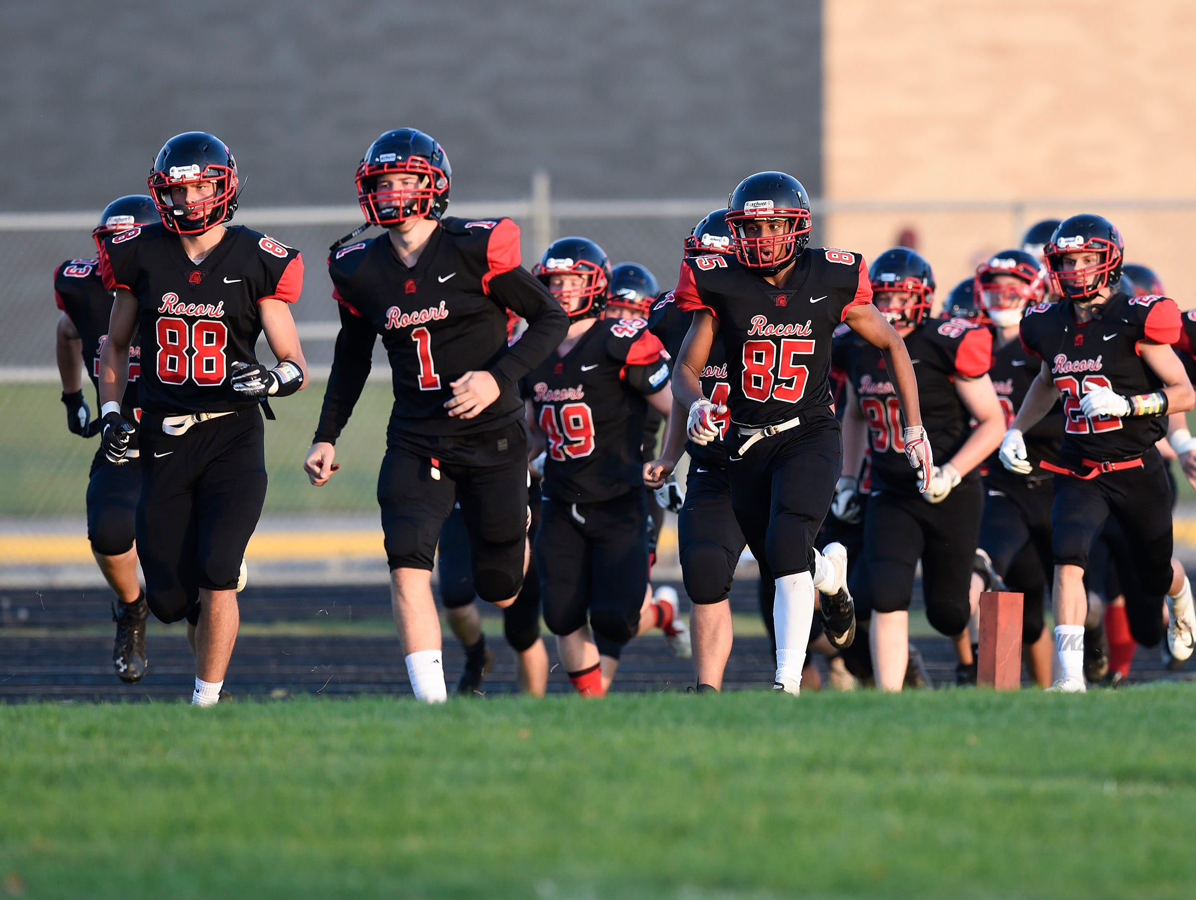ROCORI players come onto the field for their game against Becker Friday, Sept. 14, in Cold Spring.