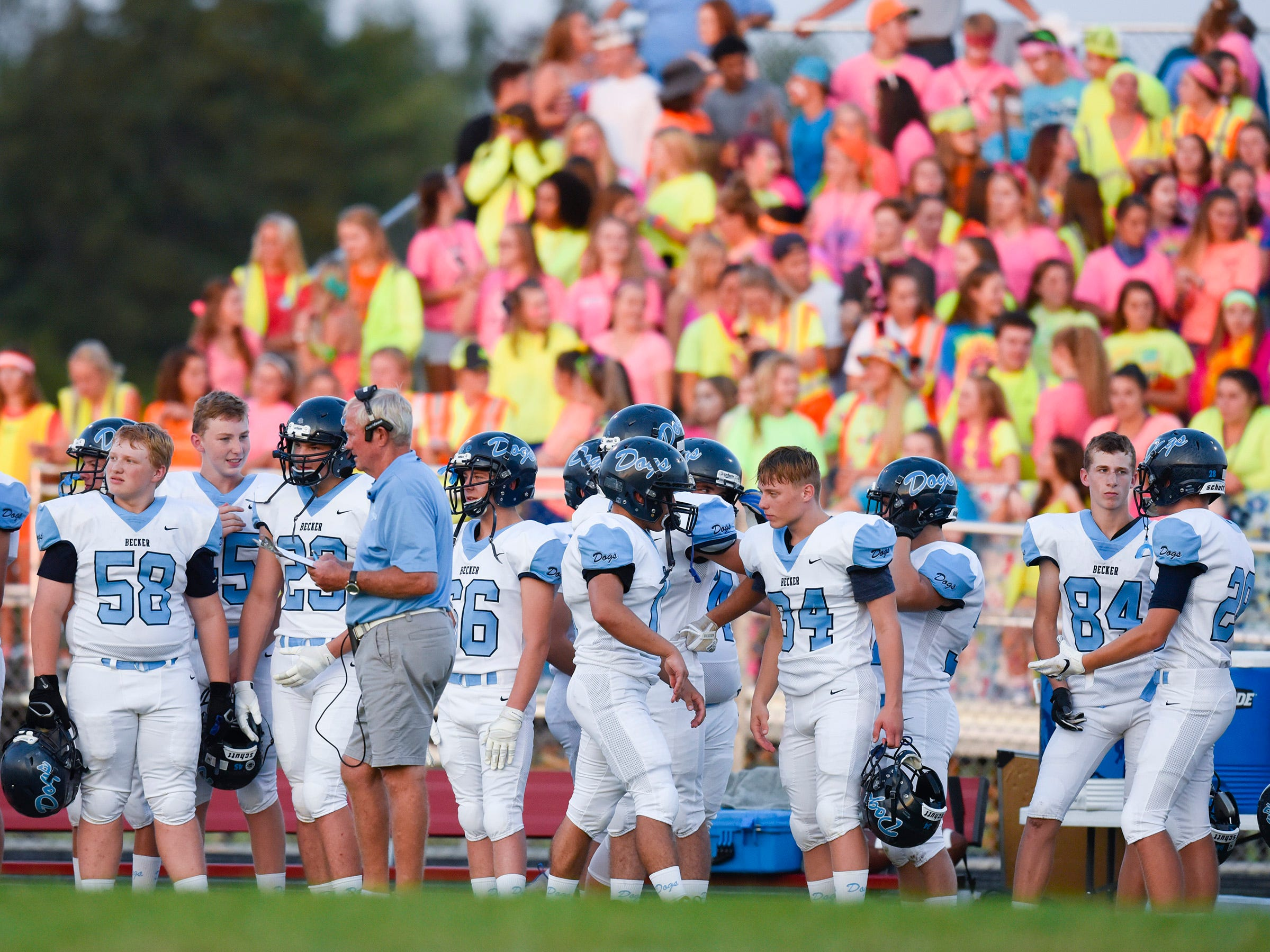 Becker players and fans on the sidelines  during the first half Friday, Sept. 14, in Cold Spring.