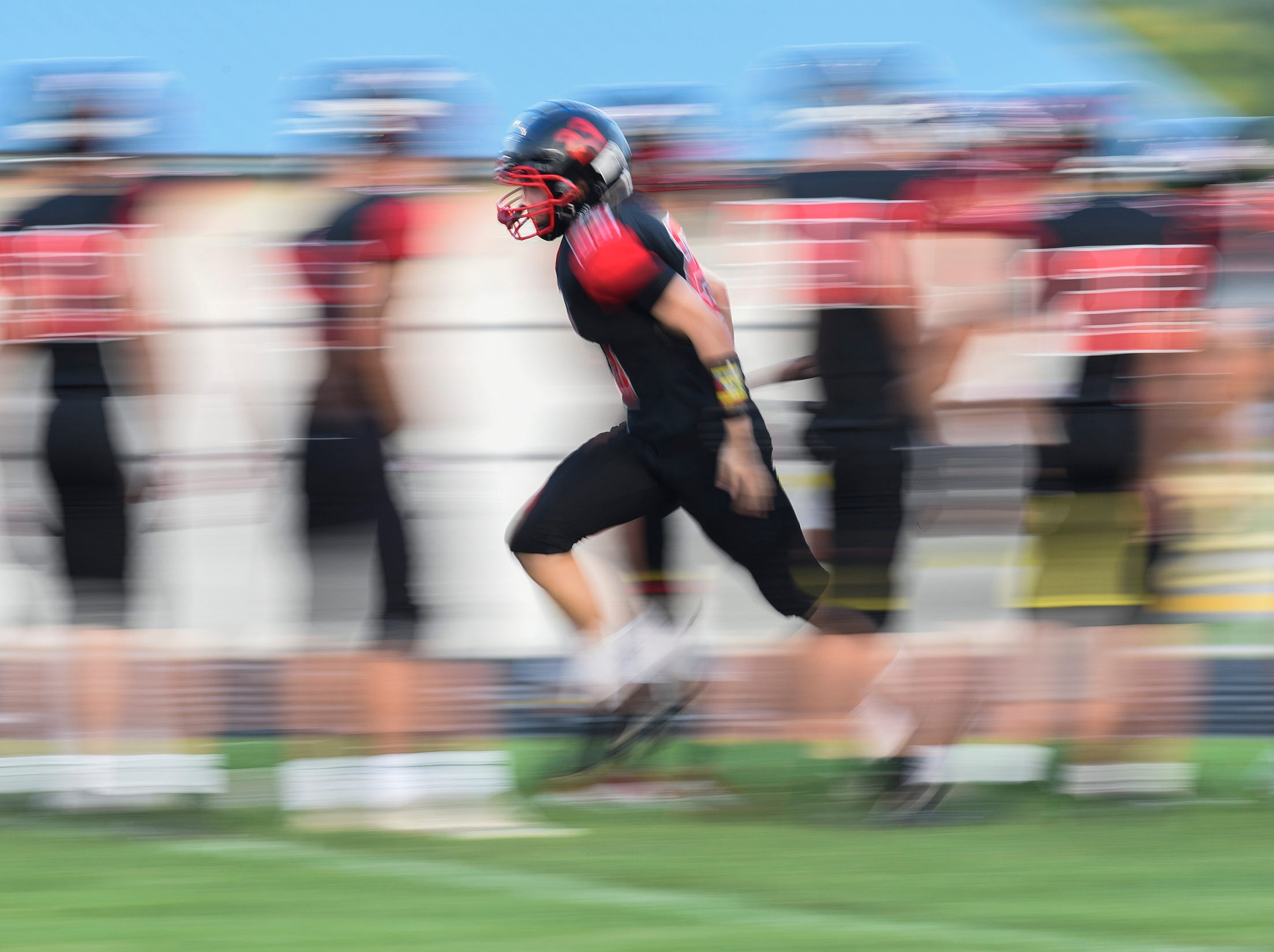 A ROCORI player runs onto the field during introductions Friday, Sept. 14, in Cold Spring.