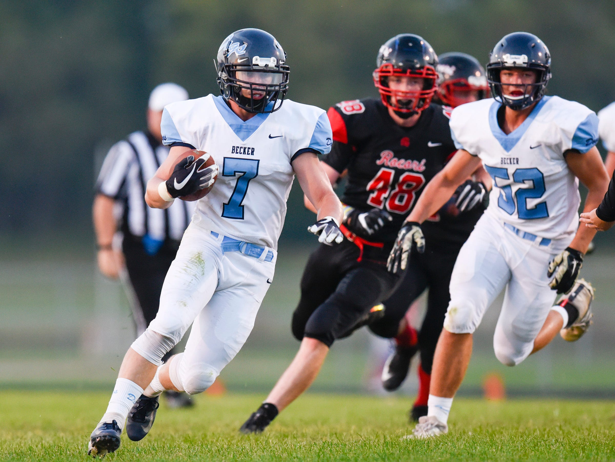 Becker's Austin Berning makes yardage during the first half Friday, Sept. 14, in Cold Spring.