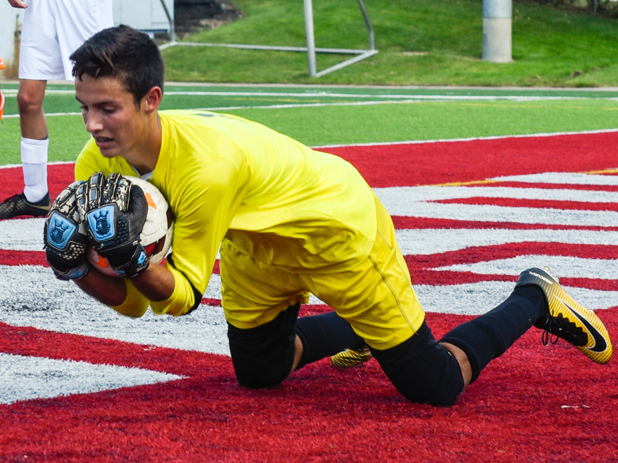 Sauk Rapids goalie Eli Rudnick makes a save against Tech during the first half Saturday, Sept. 15, at Husky Stadium.