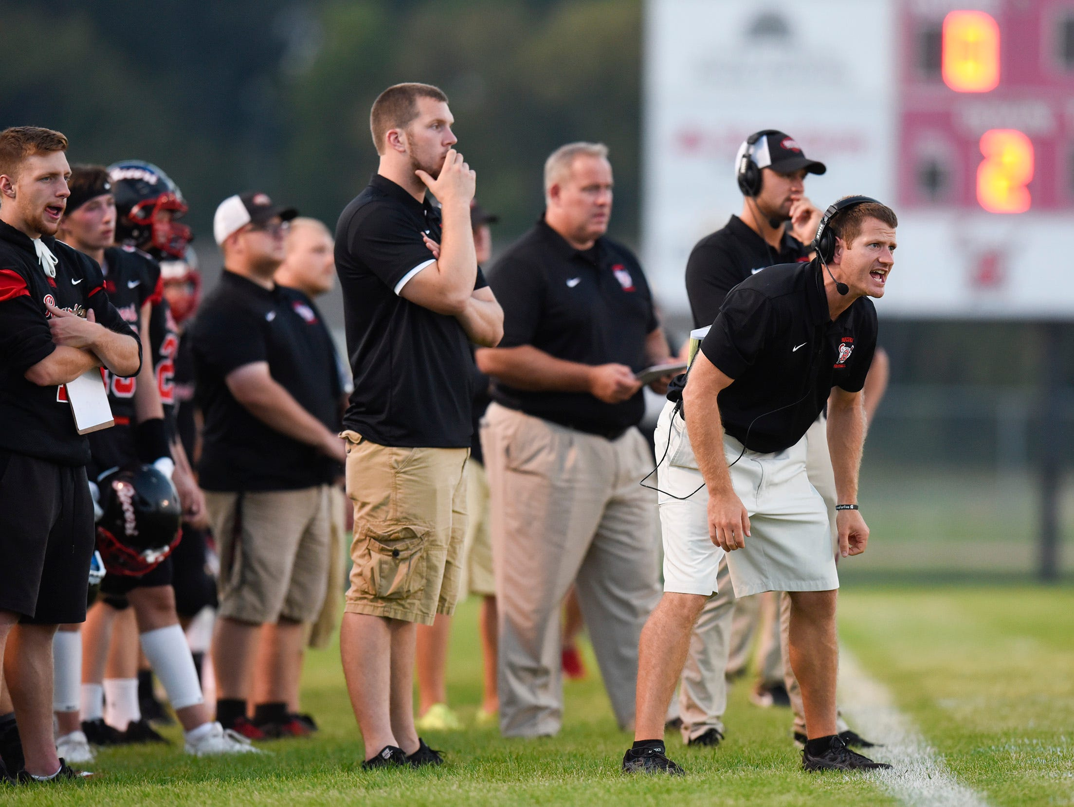 ROCORI coaches give instructions to players from the sidelines.