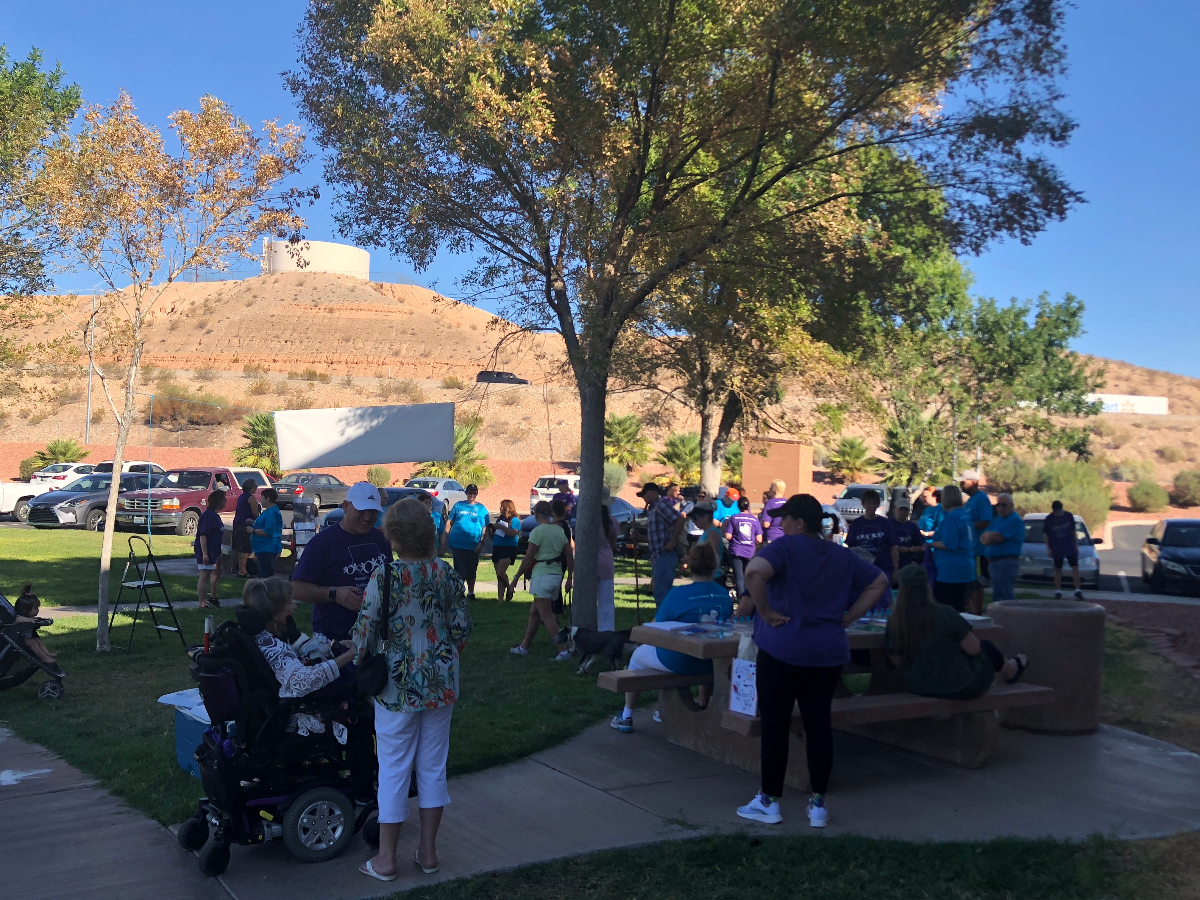 Residents gather at the Mesquite Recreation Center field before the Walk in Memory, Walk for Hope suicide prevention walk on Saturday, Sept. 15, 2018.