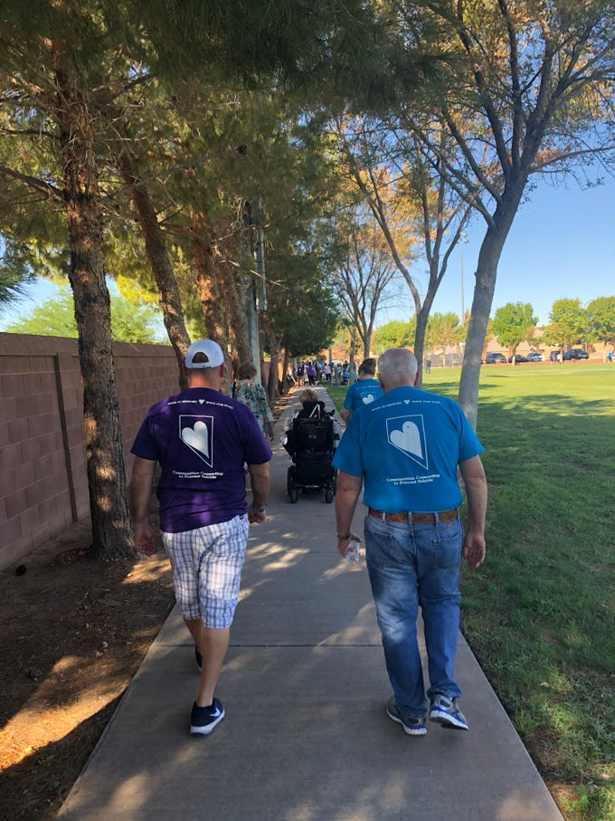 Residents participate in the Walk in Memory, Walk for Hope suicide prevention community event at the Mesquite Recreation Center on Saturday, Sept. 15, 2018.