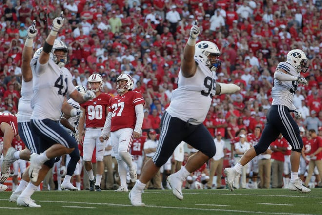 BYU players react after Wisconsin kicker Rafael Gaglianone missed a field goal in the final seconds of the second half of an NCAA college football game Saturday, Sept. 15, 2018, in Madison, Wis. BYU won 24-21. (AP Photo/Morry Gash)