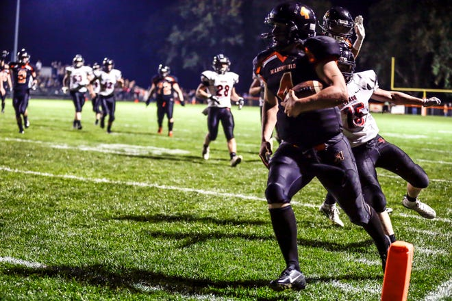 Marshfield's Ryan Krueger scores a touchdown against SPASH on Sept. 14. Krueger was named the VFA-West's offensive player of the year.