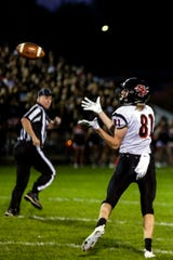 SPASH player Mason King catches a pass during a football game between SPASH and Marshfield in Beell Stadium in Marshfield, Wis., September 14, 2018.