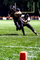 Marshfield senior quarterback Ryan Krueger has helped the Tigers get off to a 6-0 start this season with his ability to hurt defenses with his running and passing ability.