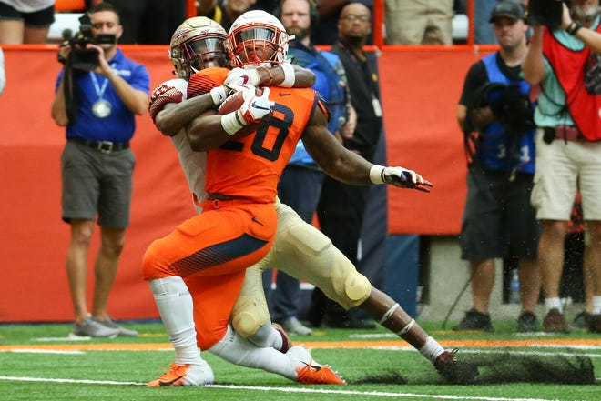 Sep 15, 2018; Syracuse, NY, USA; Syracuse Orange running back Jarveon Howard (28) is tackled while running with the ball by Florida State Seminoles defensive back Cyrus Fagan (24) during the third quarter at the Carrier Dome. Mandatory Credit: Rich Barnes-USA TODAY Sports