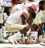 Florida State's James Blackman reacts on the bench in the final minutes of an NCAA college football game against Syracuse in Syracuse, N.Y., Saturday, Sept. 15, 2018. Syracuse won 30-7. (AP Photo/Nick Lisi)