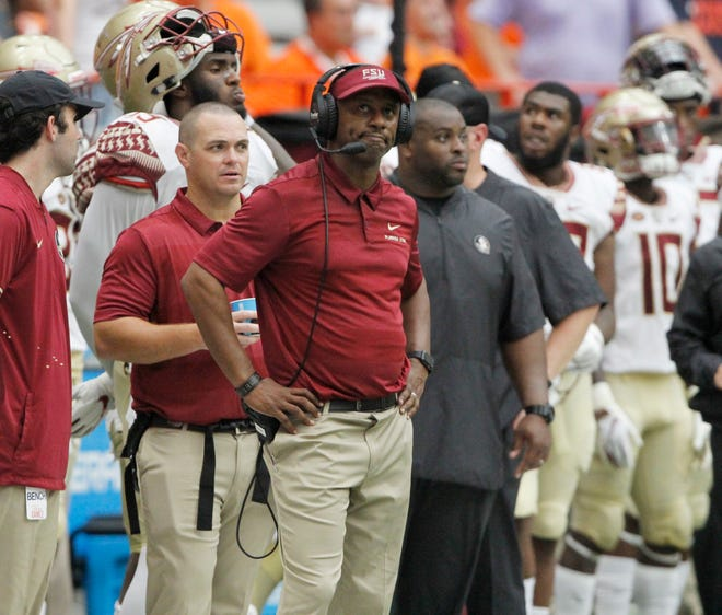 Florida State head coach Willie Taggart looks at the scoreboard late in the fourth quarter of an NCAA college football game against Syracuse in Syracuse, N.Y., Saturday, Sept. 15, 2018. Syracuse won 30-7. (AP Photo/Nick Lisi)