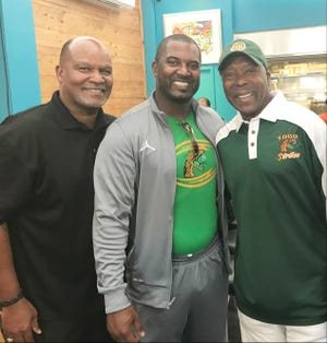 Albert Chester, left, joined head coach Willie Simmons and teammate Vince Coleman at the reunion to celebrate the 1978 national championship.