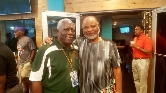 Former FAMU football head coach Rudy Hubbard (left) and his defensive line coach Amos Hill gather for the celebration of the 1978 Division I-AA national championship at The Moon on Friday, Sept. 14, 2018.