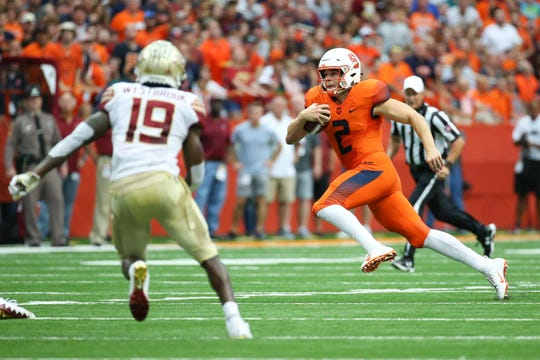 Sep 15, 2018; Syracuse, NY, USA; Syracuse Orange quarterback Eric Dungey (2) runs with the ball as Florida State Seminoles defensive back A.J. Westbrook (19) defends during the third quarter at the Carrier Dome. Mandatory Credit: Rich Barnes-USA TODAY Sports