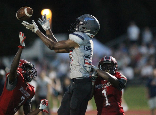 Robert Parker-Crawford goes up for a catch as Maclay beat Munroe on Friday, Sept. 14, 2018.