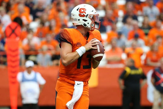Syracuse quarterback Tommy DeVito (13) drops back to pass against Florida State.