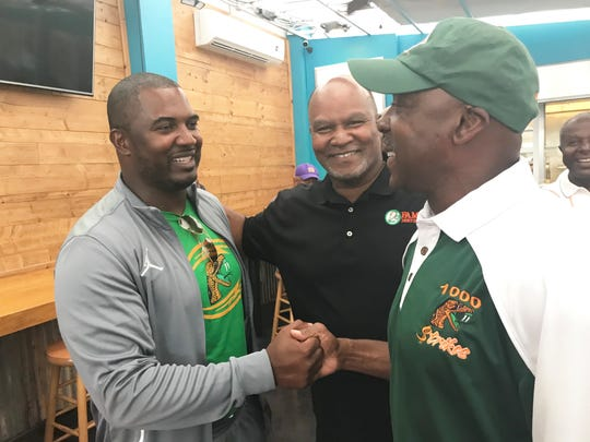 FAMU football coach Willie Simmons shares a moment with Albert Chester (center) and former MLB star Vince Coleman. Chester and Coleman were members of the 1978 national championship team.