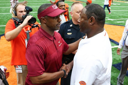 Sep 15, 2018; Syracuse, NY, USA; Florida State Seminoles head coach Willie Taggart (L) shakes hands with Syracuse Orange head coach Dino Babers (R) following the game at the Carrier Dome. Mandatory Credit: Rich Barnes-USA TODAY Sports