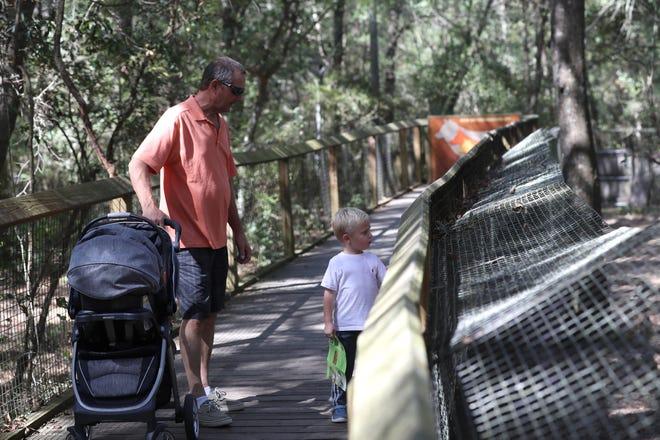 Paxton Newlin, 3, and his grandpa Ed Villoldo visit the Tallahassee Museum in 2017.