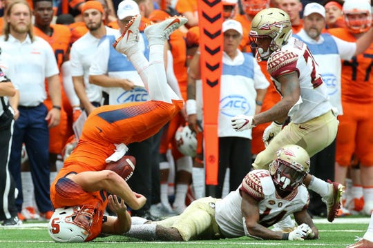 Sep 15, 2018; Syracuse, NY, USA; Syracuse Orange quarterback Eric Dungey (2) lands on his head over the tackle of Florida State Seminoles defensive back Kyle Meyers (14) during the second quarter at the Carrier Dome. Mandatory Credit: Rich Barnes-USA TODAY Sports
