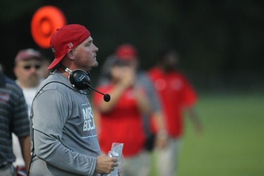 Munroe head coach Joseph Gaddy watches his team during a game against Maclay.