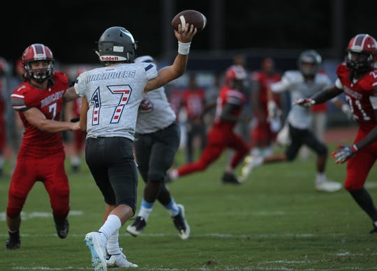 Maclay's Brecht Heuchan throws a pass against Munroe on Friday, Sept. 14, 2018.