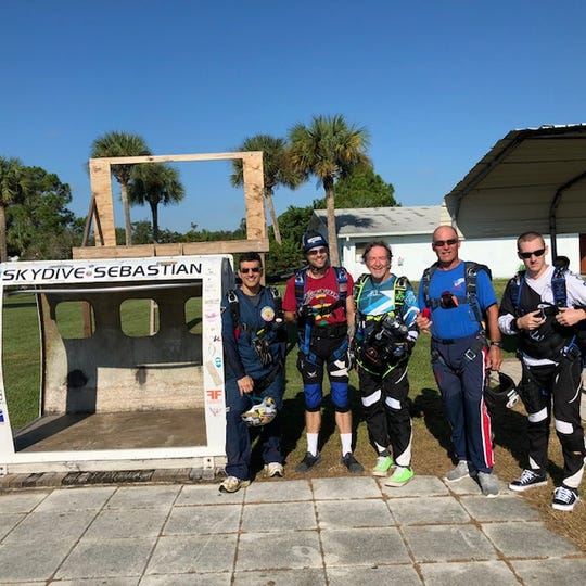 """Members of the """"Dawgfathers"""" parachuting team get ready for a practice run at Skydive Sebastian on Saturday. Randy Persi, Scott Lazarus, """"Chico"""" Tomaselli, Mike Paolin and Denis Zhuravkov will compete during the United States Parachute Association's National Competition that takes place over the next two weeks in Sebastian."""