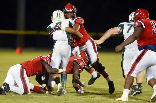 St. Lucie West Centennial High School's Jamari Stewart stands up Melbourne High School's Antonio Wright Jr. at the line of scrimmage for no gain Friday, Sept. 14, 2018 during a game at South County Stadium. Centennial won the game 54-0.