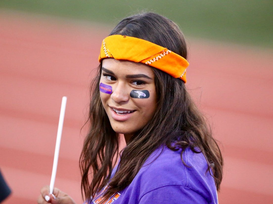 An Eastlake fan watches the Burges band before Friday's game at the Socorro Activities Center