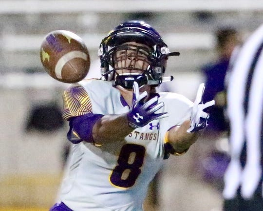 Burges wide receiver Michael Amezaga goes for a pass.