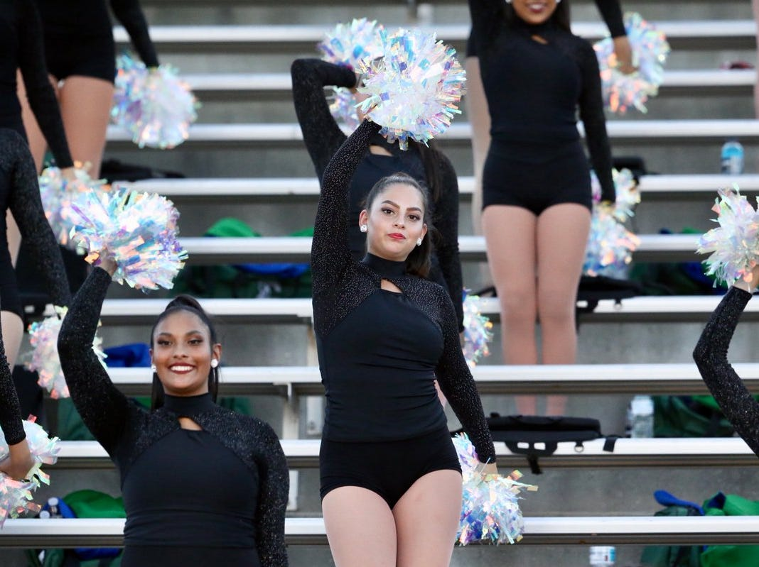 Montwood's Emerald Dancers keep up the spirit during the Rams' game against Midland Lee at the Socorro Activities Center Friday night