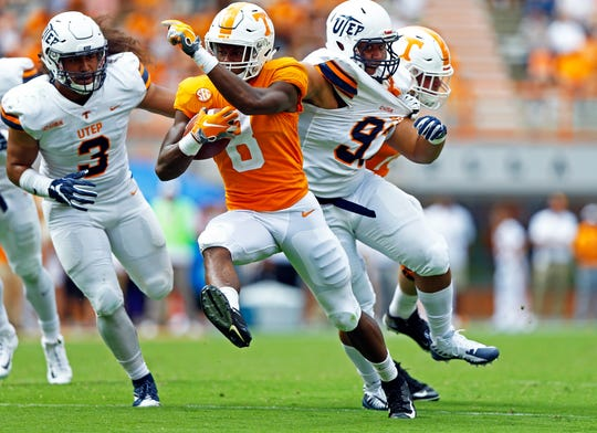 Tennessee running back Ty Chandler (8) runs for yardage as he's chased by UTEP linebacker Sione Tupou (3) in the second half of an NCAA college football game Saturday, Sept. 15, 2018, in Knoxville, Tenn.