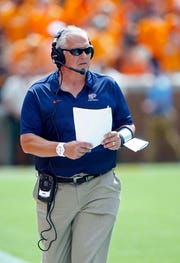 UTEP head coach Dana Dimel walks the sideline during the first half of an NCAA college football game against Tennessee on Saturday in Knoxville, Tenn.