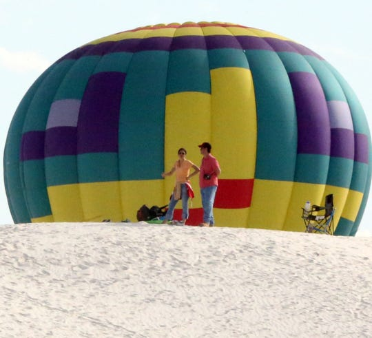 Balloons loom over the dunes at White Sands National Monument.