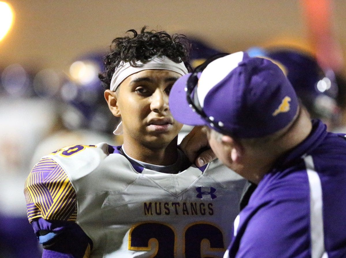 Tahes Castaneda, 26, of Burges is looked after following a hand injury at the end of the first quarter