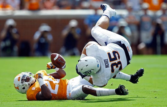 UTEP fullback Forest McKee (35) loses the ball as he's defended by Tennessee defensive back Bryce Thompson (20) in the first half of an NCAA college football game Saturday, Sept. 15, 2018, in Knoxville, Tenn. The ball went out of bounds, and UTEP retained possession.