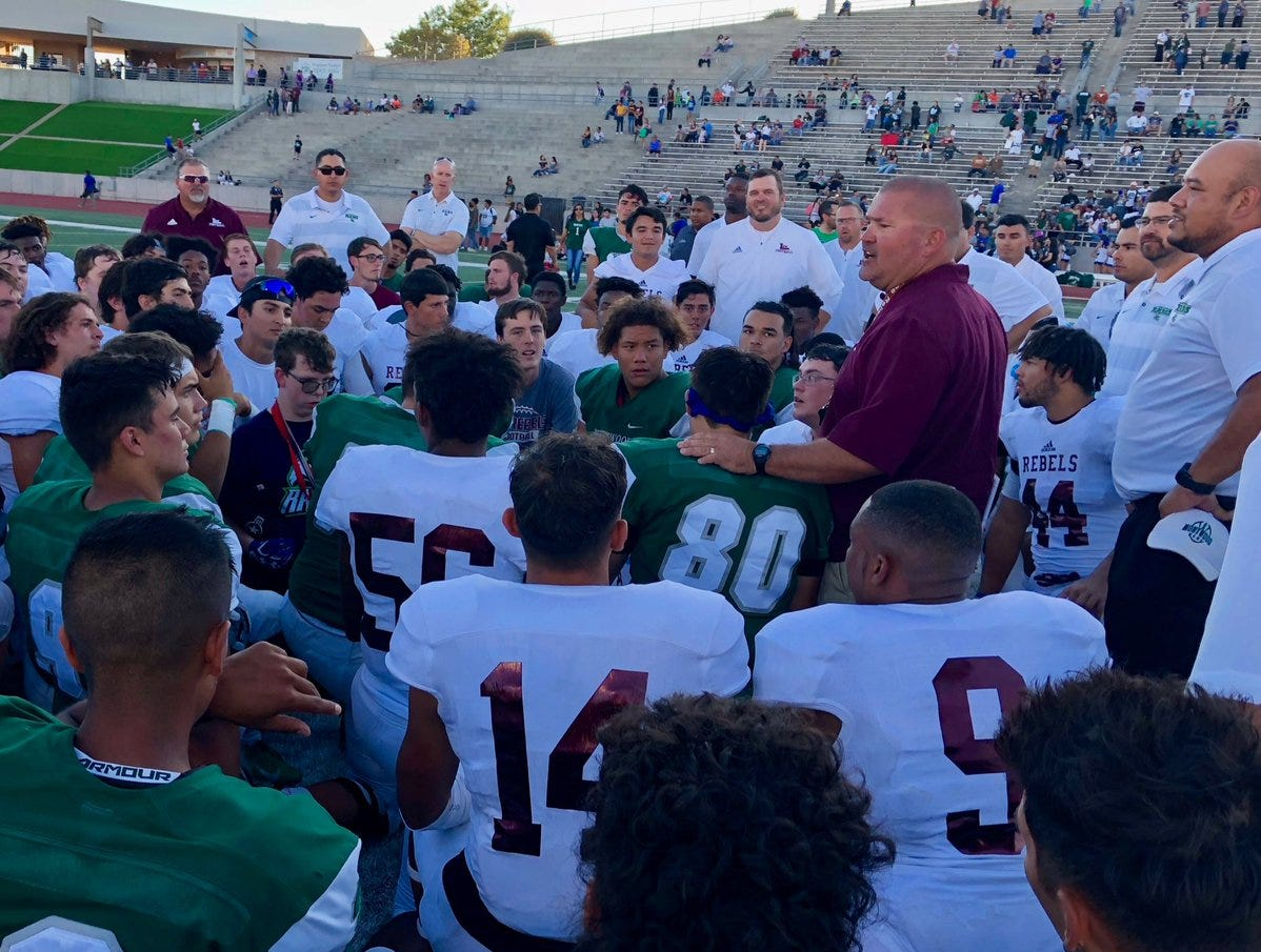 Midland Lee Coach Clint Hartman speaks to both teams before offering a prayer at center field at the end of their game Friday at the SAC.