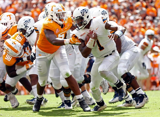 UTEP quarterback Kai Locksley (1) runs for yardage as he's chased by Tennessee defensive lineman Kyle Phillips (5) in the second half of an NCAA college football game Saturday, Sept. 15, 2018, in Knoxville, Tenn. Tennessee won 24-0.