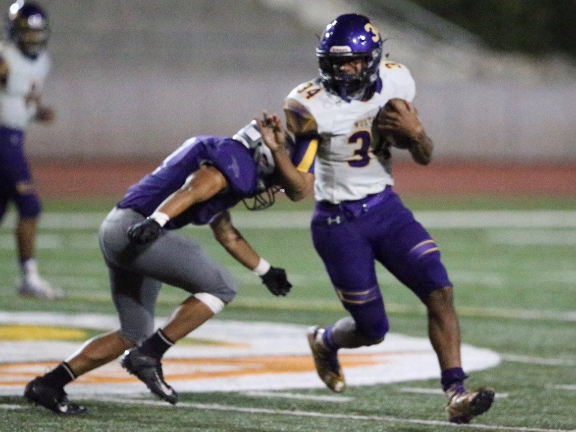 Burges WR Andrez Herrera, 3, takes a short pass against Eastlake