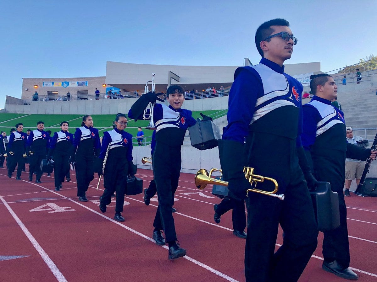 The Eastlake band marches in before their game against Burges