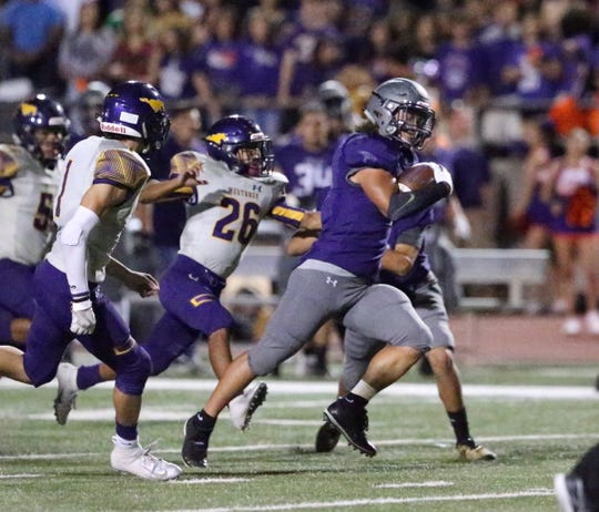 Devon Pinero of Eastlake steams to the end zone for a score against Burges Friday night in the SAC. A missed extra point brings score to 9-0