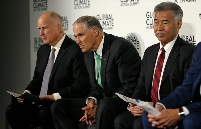 From left, California Gov. Jerry Brown, Washington Gov. Jay Inslee and Hawaii Gov. David Ige listen to questions during a news conference at the Global Action Climate Summit on Thursday in San Francisco.