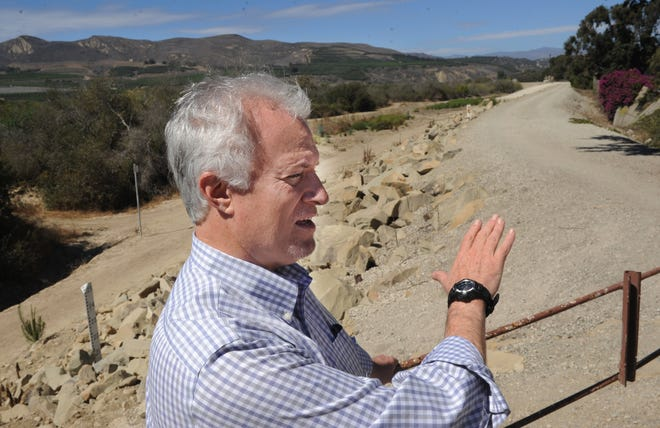 Peter Sheydayi, deputy director of the Ventura County Watershed Protection District, explains deficiencies in a levee system that protects homes and businesses along the Ventura River.