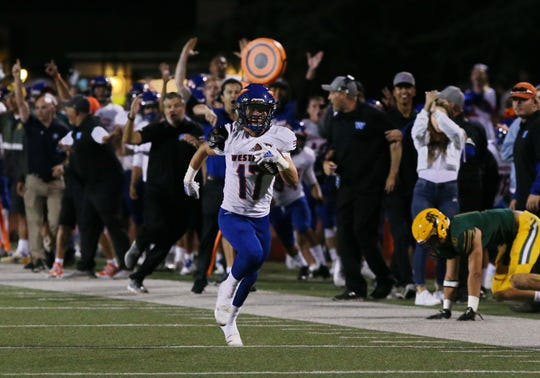 Westlake High's James Anders is off and running to the end zone to score a touchdown in the Warriors' 34-0 win over visiting Moorpark on Friday night.