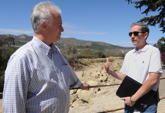 From left, Peter Sheydayi, deputy director of the Ventura County Watershed Protection District, and Salvador Diaz-Rubin, project manager with the Ventura County Public Works Agency, discuss the VR-1 levee at Main Street in Ventura.