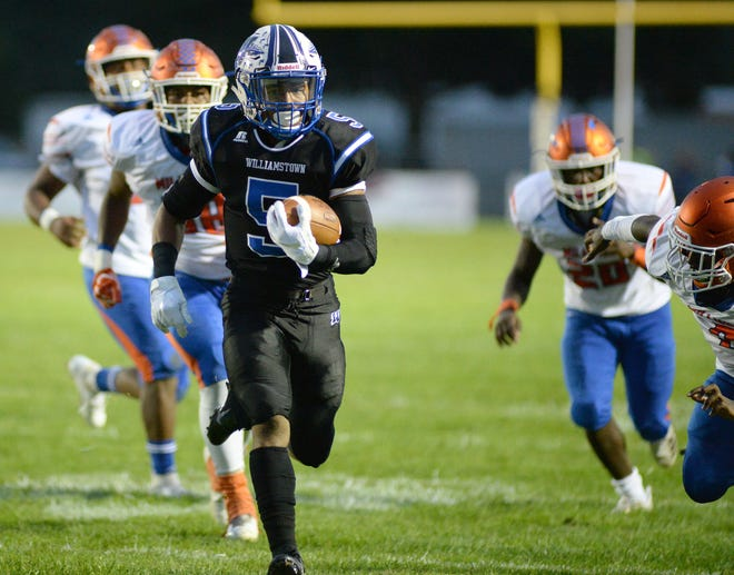 Williamstown's Wade Inge carries the ball for a Braves touchdown during the first half against Millville at Williamstown High School, Friday, Sept. 14, 2018.